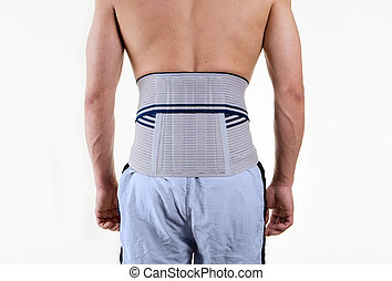 Shirtless Man Wearing Brace to Support Lower Back