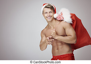 Shirtless man with Christmas sack