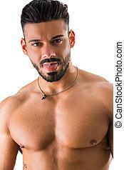 Shirtless man with piercing