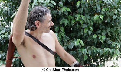 primitive bow - shirtless man with primitive bow