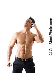 Shirtless muscle man thinking looking up, scratching head