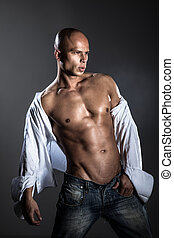 Shirtless muscled fitness man. Studio shot isolated on grey...