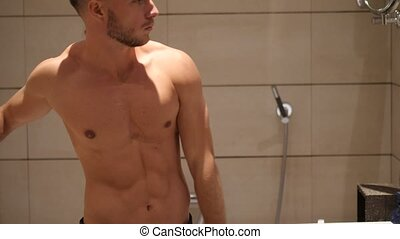 Shirtless muscular handsome man in bathroom - Shirtless...