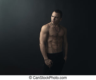 muscular man looks back - shirtless muscular man looks back