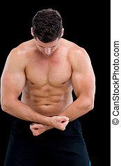 Shirtless muscular man posing