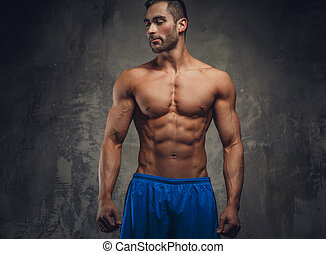 Shirtless muscular man posing.