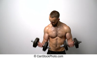 Shirtless muscular man training with Resistance Band -...