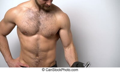Shirtless muscular man training with Resistance Band