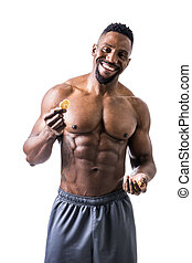 Shirtless muscular young man eating rice cracker