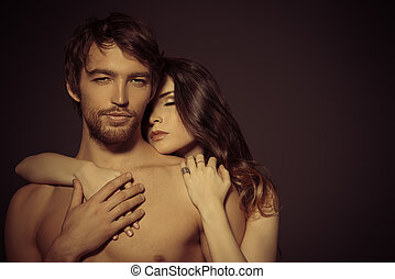 shirtless - Beautiful passionate naked couple in love. Over...
