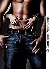 in jeans - shirtless wet muscular man in jeans and woman...