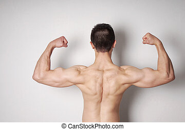 man flexing biceps and back muscles