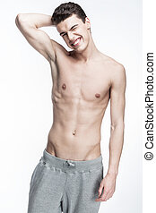 shirtless young man on light background
