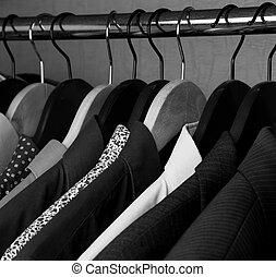 shirts and jackets in wardrobe isolated closeup