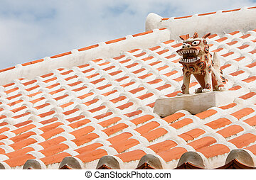 Shisa - A guardian shisa lion dog, on the roof of an ...