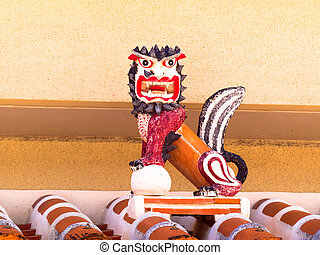 Shisa on the plaster roof