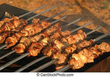 Shish a grill - The image of fried meat on skewers