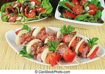 Shish-kebab and salads