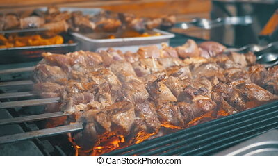 Shish Kebab Cooked on the Grill on the Street Market. Street...
