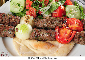 Shish kebab - Grilled meat with salad