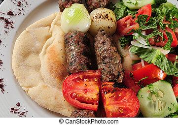 Shish kebab with vegetable on pita bread