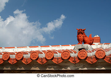 Shisha Dog/Lion on a rooftop of an Okinawan House. You will most likely find a pair of Shishas on a rooftop or at the entrance of an Okinawan home. Shisas are wards, protecting from evil.