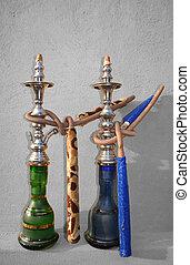 Shisha Pair - Desaturated - Two Arabic Shisha pipes sitting...