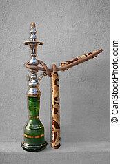Shisha Single - Desaturated - An Arabic Shisha pipe sitting...