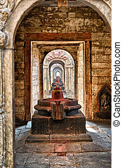 shiva lingam of Pashupatinath temple and cremation ghats,...