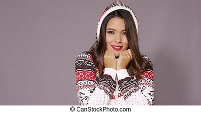 Shivering young woman in stylish winter fashion cuddling ...