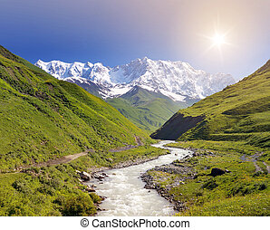 Shkhara mountain in the Caucasus - Summer landscape with...