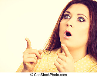 Shocked amazed woman gesturing with hands