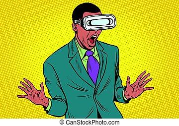 Shocked African American in VR glasses