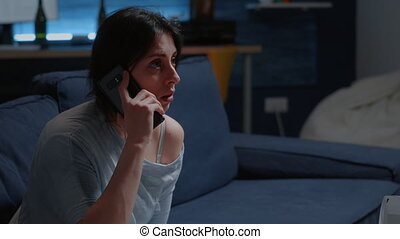 Shocked alone woman listening phone call, receving tragic news dropping smartphone feeling emotionally unstable, scared, lonely desperate, vulnerable. Traumatised person suffering from chronic disease