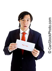 Shocked Asian Man Holding Foreclosure Notice Isolated on White