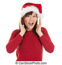 Shocked Asian Santa woman