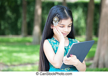 Shocked at tablet - Closeup portrait, adorable girl shocked...