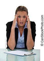 Shocked blond office worker