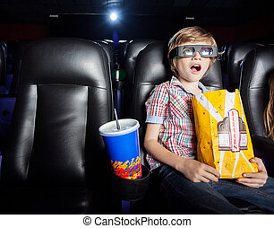 Shocked Boy Watching 3D Movie In Theater