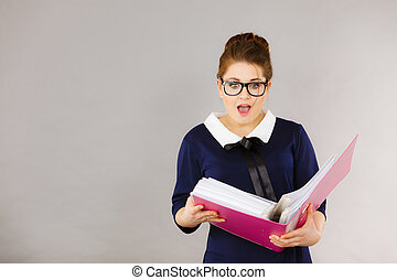 Shocked business woman looking at documents