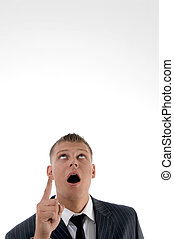 shocked businessman pointing upward