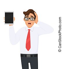 Shocked businessman showing new tablet computer and holding ...