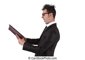 shocked businessman with book