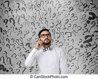 Shocked businessman with question marks