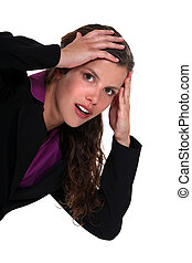 Shocked businesswoman with hands on head