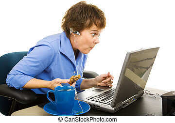 Shocked by Internet Content - Office worker snacking and...