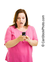 Shocked by Text Message - Pretty plus-sized woman reacting...