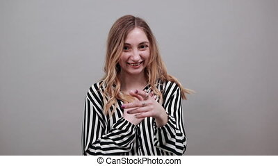 Shocked caucasian woman looking at camera, covered mouth with hand.