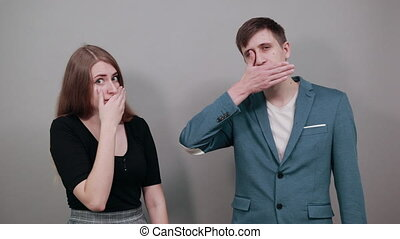 Shocked covering mouth with hands scared, feel horrified stunned looking, startled mute keep silent secret portrait, surprised face afraid in silence, speechless. Young attractive couple