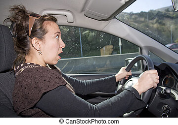 Shocked driving - An image of a young woman getting shocked...